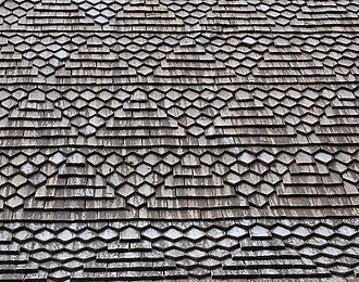 Roof shingle - Heinola Rural Parish church, in Heinola, Finland. It was completed in 1755 and built most likely by August Sorsa. Close-up of the wooden shingle roof. The patterning is said to originate from Islamic architecture.