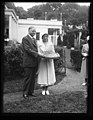 Herbert Hoover and woman with large pie outside White House, Washington, D.C. LCCN2016889852.jpg