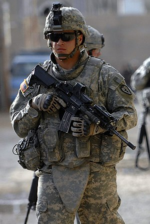 Improved Outer Tactical Vest - A soldier from the 25th Infantry Division wears an Improved Outer Tactical Vest (IOTV) with a groin protector in Iraq in February 2008.