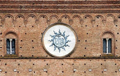 Trigramma di Cristo IHS, dipinto da Battista di Niccolò, Palazzo Pubblico