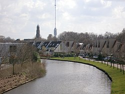 The river Hollandse IJssel; in the background the Dutch Reformed Nicolaas church and the Gerbrandy Tower