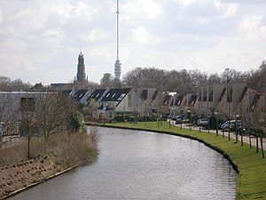 IJsselstein - Hollandse IJssel through IJsselstein with church and Gerbrandy Tower in background