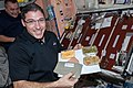 ISS-38 Michael Hopkins with his Thanksgiving meal.jpg