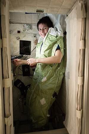 Samantha Cristoforetti - Samantha Cristoforetti in a special sleep bag that stops the person from drifting around in the micro-g environment of ISS.