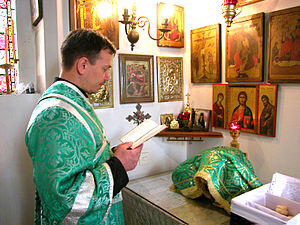 Liturgy of Preparation - Subdeacon reading the names of the living and the departed during the Liturgy of Preparation.