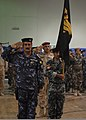 Iraqi police Col. Salah salutes U.S. Soldiers during a transfer of authority ceremony at Contingency Operating Site Warrior, Iraq, Aug 110806-A-FD969-057.jpg