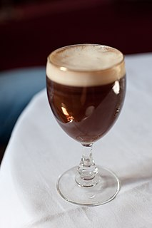 Irish coffee cocktail of hot coffee, Irish whiskey and sugar