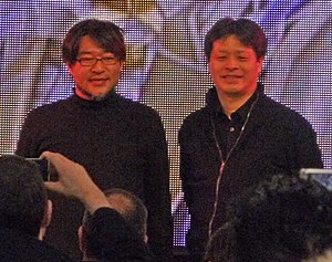 Yoshinori Kitase - Yoshinori Kitase (right) and art director Isamu Kamikokuryo (left) at HMV's Final Fantasy XIII launch event in London in March, 2010.