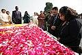 Jacksons visit Gandhi's grave.jpg
