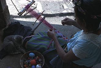 Jakaltek people - Jakaltek Maya brocading a hair sash on a backstrap loom.