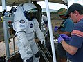 Jake Maule and Mike Damon swab spacesuit at NASA Desert RATS 2006.JPG