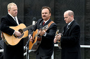 "Jimmy Fortune - Jimmy Fortune, center, sings ""More Than a Name on The Wall"" with Jamie Dailey and Darrin Vincent."