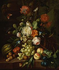 Basket of flowers with fruit