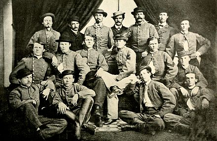 Confederate Cavalry Colonel John S. Mosby and some of his men-Top row (right to left): Lee Herverson, Ben Palmer, John Puryear, Tom Booker, Norman Randolph, Frank Raham.# Second row: Robert Blanks Parrott, John Troop, John W. Munson, John S. Mosby, Newell, Neely, Quarles.# Third row: Walter Gosden, Harry T. Sinnott, Butler, Gentry - 43rd Battalion Virginia Cavalry