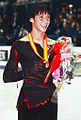 Johnny Weir Podium 2008 GPF (retouched).jpg
