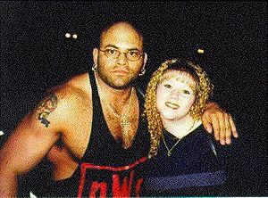 Konnan - Konnan in 1998 as a member of the nWo Wolfpac with a fan.