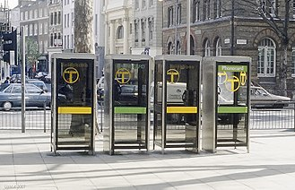 KX telephone boxes - A line of KX100 kiosks with the original logo and insignia, during the changeover from smoked glass to clear.