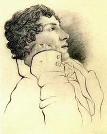 Portrait in pencil of a man in his mid-twenties with medium-length curly hair. He is leaning on his right arm and faces right, he is wearing a white jacket.
