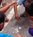 Kids playing pogs.jpeg