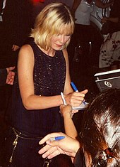 Dunst signing autographs at the Toronto International Film Festival, 2005