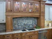 picture of a kitchen cabinet on display in a home center store. beautiful ideas. Home Design Ideas