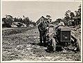 Knut Hamsun (1859-1952) ved siden av en uidentifisert mann på traktor, juni 1929 (11813497925).jpg