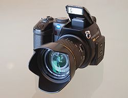 The DIMAGE A200, a bridge-type camera, the most sophisticated digital camera made by Konica Minolta, shortly before its  fusion with Sony