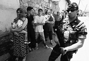 Kosovo Force - Italian KFOR soldier protecting Serb civilians in Orahovac during the 2004 unrest