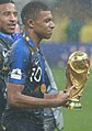 Kylian Mbappé World Cup Trophy.jpg