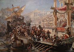Two ships collide in a flooded arena or stone-lined body of water, and their crew mingle in fight. The shorter boat is powered by oars, the taller by sails. The emperor and crowd look on.