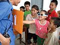 Lao children enjoy 3D picture.jpg