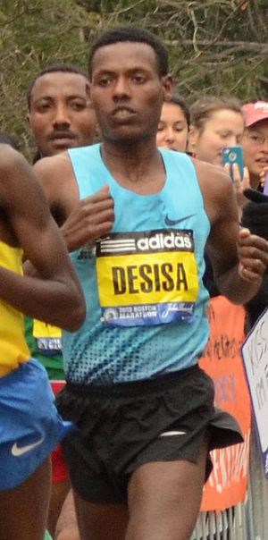 Lelisa Desisa - Lelisa Desisa Benti, male winner of 2013 Boston Marathon almost at the end of the Wellesley College scream tunnel.