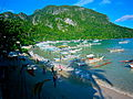 Long boats await island hopping passengers to explore Bacuit Bay.JPG