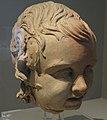 Louvre-Lens - Les Étrusques et la Méditerranée - 002 - Vatican, musée grégorien étrusque, inv. 13761 (Tête de statue d'enfant) (B).JPG