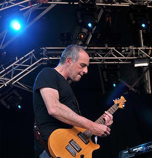 Loyd Grossman - Loyd Grossman playing guitar on stage