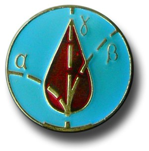 Chernobyl liquidators - The central detail of the Liquidators' medal, with traces of alpha (α) and beta (β) particles and gamma (γ) rays over a drop of blood.