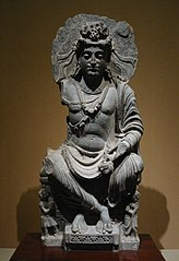 Maitreya, with Kushan devotee couple. 2nd century Gandhara.