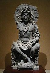 Maitreya, com par de devoto de Kushan. 2nd século Gandhara.