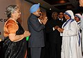 Manmohan Singh meeting the nuns from missionaries of charity at a reception for Indian community hosted by the Indian High Commissioner, in Dar es Salaam, Tanzania. Smt. Gursharan Kaur.jpg