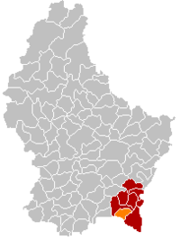 Map of Luxembourg with Mondorf-les-Bains highlighted in orange, the district in dark grey, and the canton in dark red