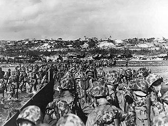 Battle of Okinawa - US Marine reinforcements wade ashore to support the beachhead on Okinawa, April 1, 1945.