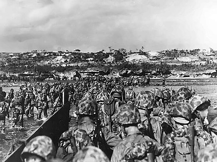 US Marine reinforcements wade ashore to support the beachhead on Okinawa, April 1, 1945. Marines land on Okinawa shores.jpg
