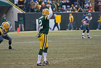 Mason Crosby - In a 2009 game, Mason Crosby prepares to kickoff.