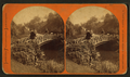 Men walking over a bridge in a park, by Liebich's Photographic Landscapes.png