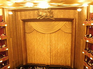 Metropolitan Opera - The gold curtain, a gift of the Metropolitan Opera Club, in the auditorium