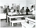Miss Limena Robati (right), and Mrs Louisa Cowan instruct patients in cane basket and ukulele making, 1965.jpg