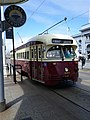 Muni 1074 at the Ferry Building, March 2012.jpg
