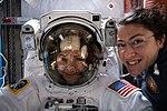 NASA astronauts Christina Koch and Jessica Meir prepare for a spacewalk.jpg