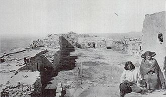 Nampeyo - Nampeyo and her brother Tom Polacca on the rooftop of the Corn clan dwelling at the Hano village, photograph taken in 1875 by William Henry Jackson (Colorado Historical Society)