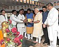 "Narendra Modi being presented a book ""Bhagwan Budh or Unka Dharm"" at Chaitya Bhoomi, in Mumbai. The Governor of Maharashtra, Shri C. Vidyasagar Rao, the Chief Minister of Maharashtra.jpg"